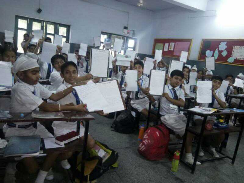 Dasmeshians enjoying calligraphy activity July 06,2019.